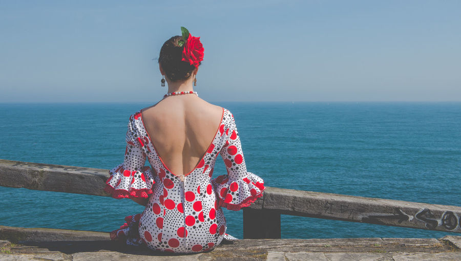 Andalucía Flamenco Spanish Woman Beauty In Nature Clear Sky Day Horizon Over Water Leisure Activity Lifestyles Nature One Person Outdoors Railing Real People Rear View Red Scenics Sea Sky Standing Water Young Adult Young Women
