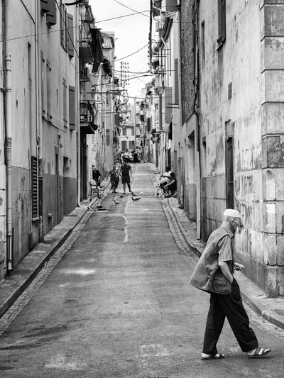 France Immigration Old Man Perpignan Alley Bleak City Cultures Immigrants Muslim People Real People Religion Residential District Sitting On The Street Street Streetphotography Suburb