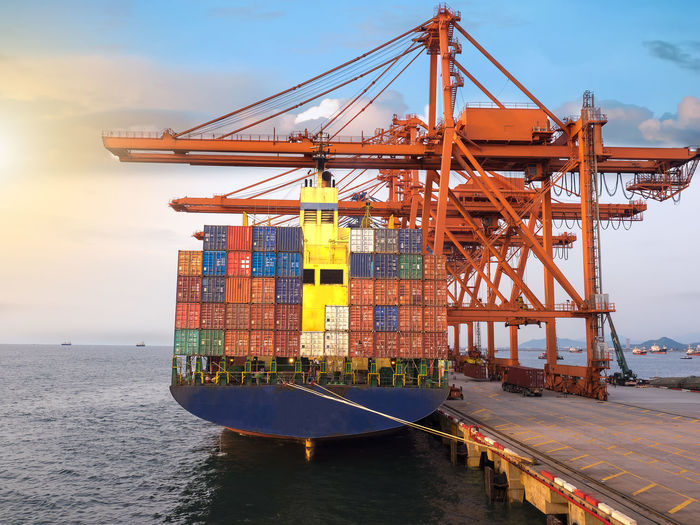 Container vessel loading full capacity at port of thailand DG Thailand Alongside Berth Cargo Container Cloud - Sky Crane - Construction Machinery Day Discharge Export Freight Transportation Full Import Industry Loading Nautical Vessel Offshore Platform Outdoors Port Sea Shipping  Sky Transportation Water Waterfront