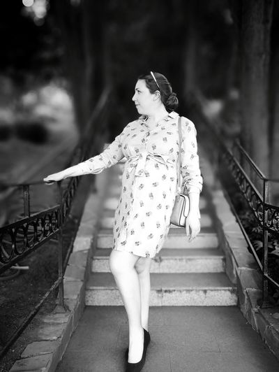 Woman Standing On Staircase In City