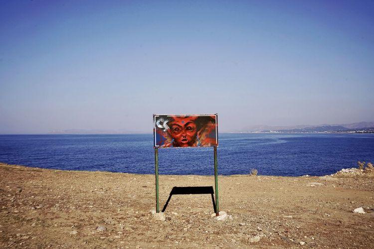 Lifeguard chair on beach against clear sky