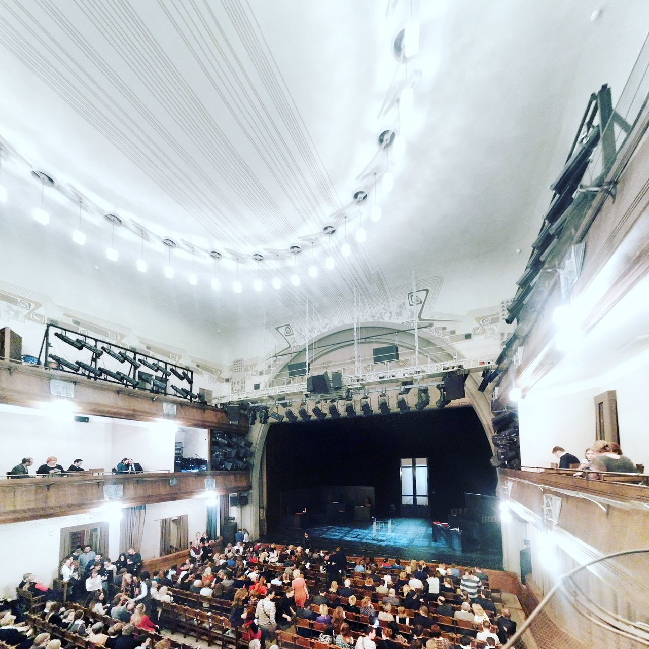 large group of people, real people, crowd, men, architecture, audience, indoors, women, built structure, mixed age range, lifestyles, leisure activity, arts culture and entertainment, event, watching, illuminated, performance, sitting, day, people, adult