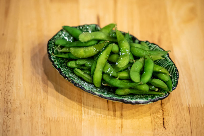 High angle view of green vegetables on table