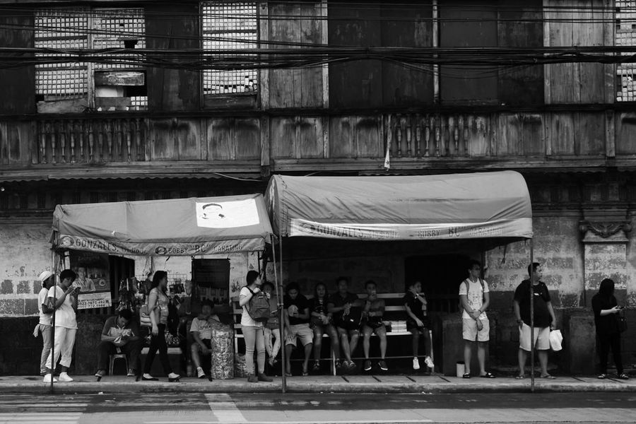 Black And White Friday Real People Large Group Of People Men Women Built Structure Building Exterior Architecture Leisure Activity Lifestyles Mixed Age Range Outdoors Crowd Day City Adult Adults Only waiting game Waiting People Waiting In Line Waiting For The Bus Waiting Area Waiting Room EyeEmNewHere Black And White Friday EyeEmNewHere