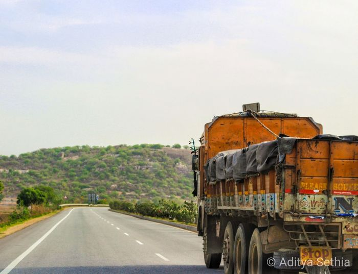 Transportation Road Sky Mode Of Transportation Day Nature Land Vehicle Motor Vehicle No People Plant Tree Truck Car Travel Outdoors Semi-truck Land on the move Motion Symbol
