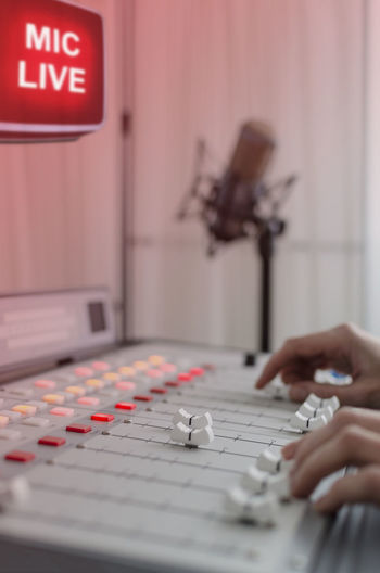 Close-up of hands in radio studio