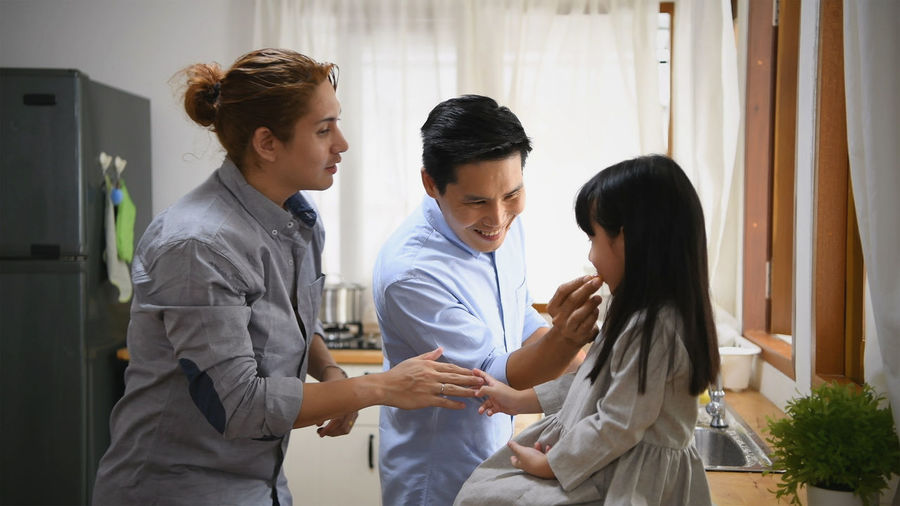Togetherness Young Adult Indoors  Adult Standing Men Young Men Three Quarter Length Young Women Healthcare And Medicine Occupation Smiling Hospital Communication Real People Side View Happiness Doctor  Care Responsibility
