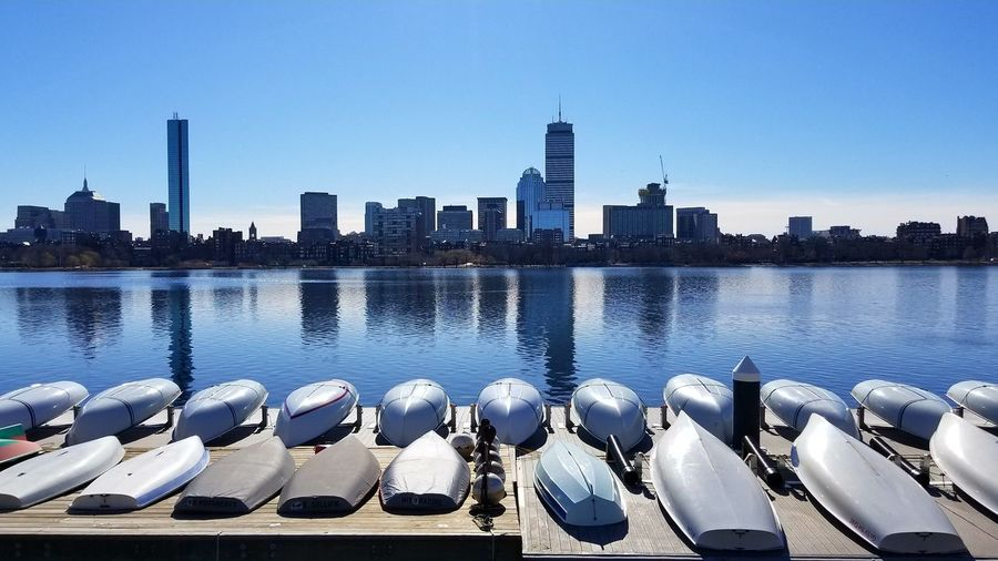 Blue on blue. EyeEm Best Shots Boats Boston Skyscraper City Urban Skyline Water Cityscape Architecture Building Exterior Outdoors Modern Downtown District No People Sky Clear Sky Day Built Structure Tower Travel Destinations