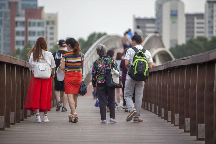 Bridge Casual Clothing City City Life Day Full Length Leisure Activity Lifestyles On The Bridge Outdoors People Seonyudo Seonyugyo Sky The Way Forward Walking