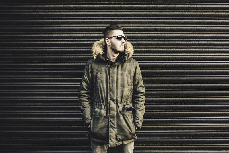 Urban fashion. Jackandjones Hawkers Style Stylish Winter Sunglasses Urban Street Fashion Camo Jacket Metal One Person Adults Only One Man Only Pattern Only Men Beard Outdoors People Day Young Adult Corrugated Iron Standing Mid Adult Mid Adult Men Casual Clothing Mustache Men Lifestyles