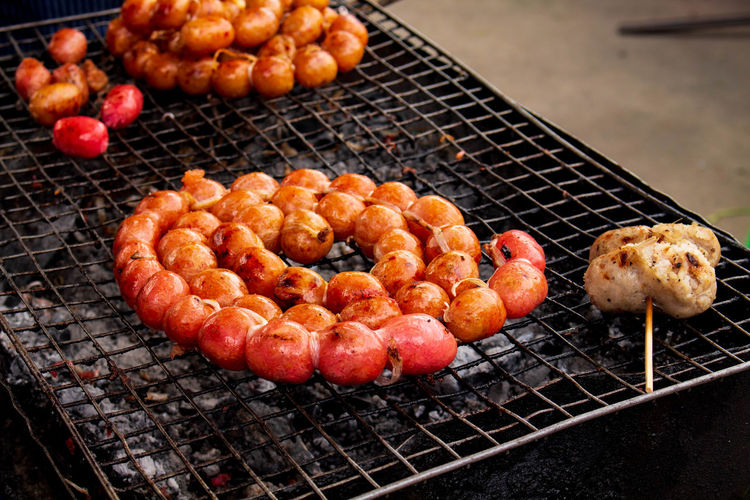 High angle view of oranges on barbecue