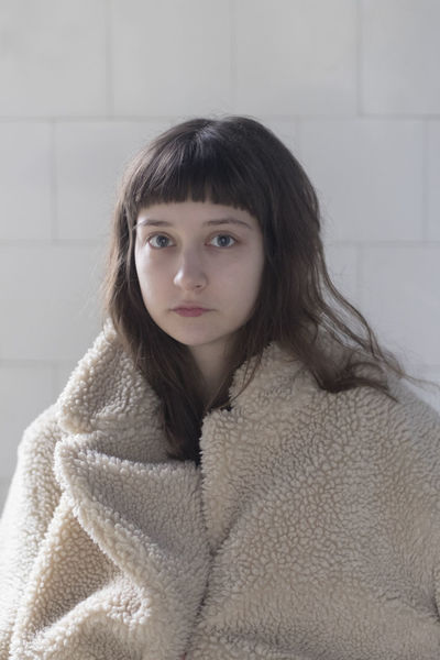 Portrait of a young female model with fake fure coat looking at camera Fashion Fine Art Photography Natural Anxiety  Bangs Beautiful Woman Beauty Clothing Coat Depression - Sadness Dreamy Eyes Hair Indoors  Indoors  Lifestyles Looking At Camera Mistery One Person Portrait Real People Sadness Warm Clothing Young Adult Young Women Inner Power