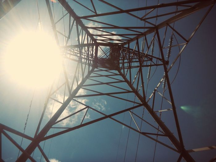 Tower Nature EyeEm Nature Lover EyeEmNewHere EyeEm Best Shots IPhoneography Electricity  Electricity Pylon Cable Sun Power Supply Connection Sky Fuel And Power Generation Low Angle View No People Sunlight Day Clear Sky Technology Outdoors
