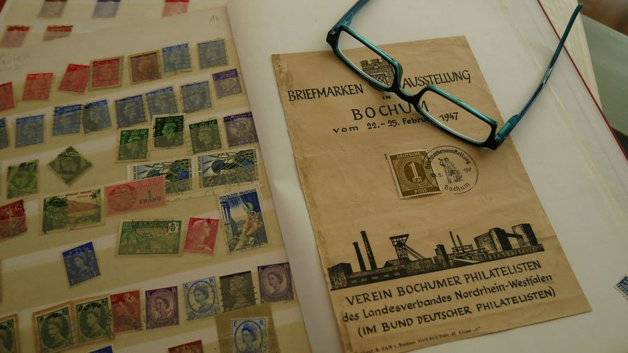 Collecting stamps - a part of history Collectors Item Glasses Collector Exhibition Group Of Philatelists Politics Conversation History Philatelist Stamps EyeEm Gallery Eyem Gallery Close-up German 1947 Bochum Certificate Stamp Bochumer Kuhhirte Ausstellung Von Briefmarken Lieblingsteil