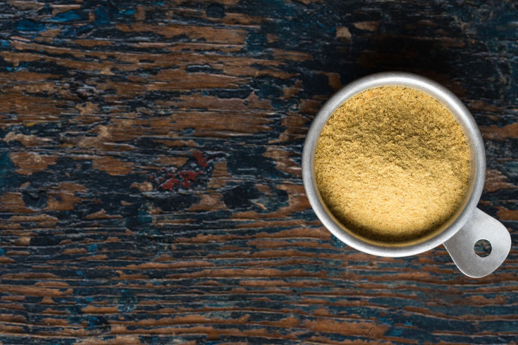 Nutritional Yeast Nutritional Yeast Nutritional Yeast  Yellow Copy Space Measuring Cup Ingredient Isolated Macro Nobody Top View Directly Above
