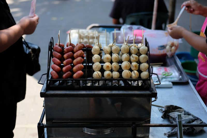 Food on barbecue grill at market