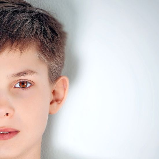 Cropped Portrait Of Boy Against White Background