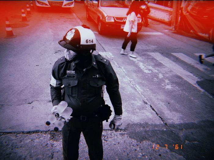 น้ำเอยน้ำใจ Trafficpolice Security City Safety Protection Uniform Street Real People Men Standing Police Force Transportation Accidents And Disasters Road Day People
