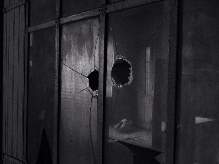 Damaged window of abandoned house