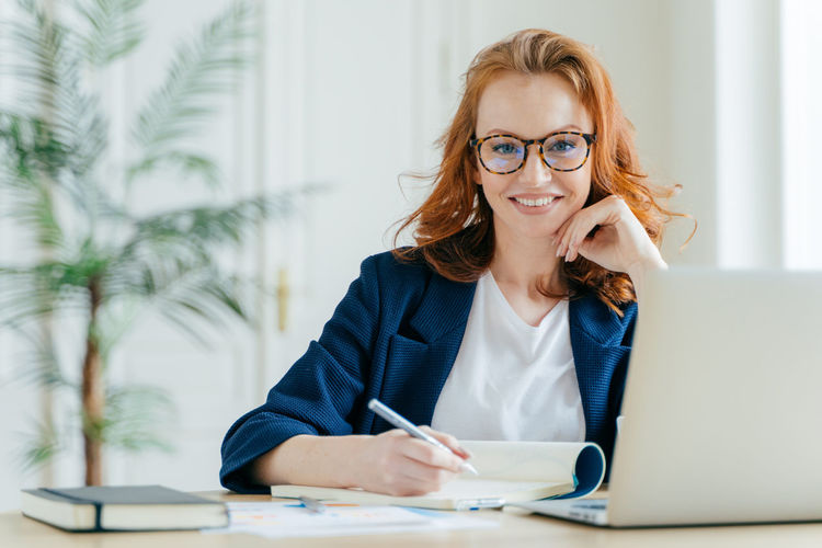 Portrait of businesswoman working at desk in office