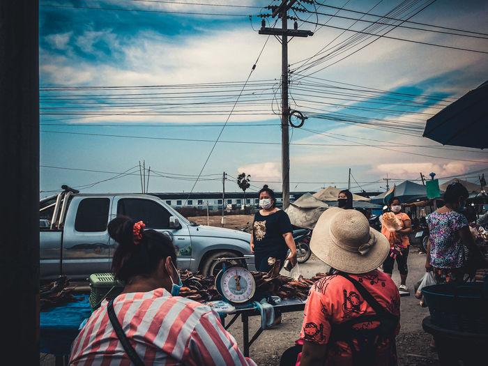 People on street against sky