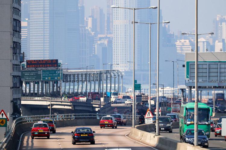 Traffic on road against buildings in city