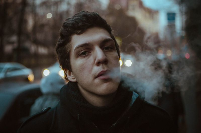Portrait of man exhaling smoke