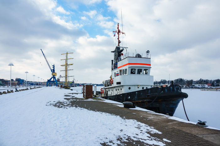 Winter time in the city port of Rostock, Germany. City Frozen Harbor Icebreaker Relaxing Rostock Sailing Ship Travel Winter Cold Temperature Crane Journey Nature No People Outdoors Port River Sky Snow Tourism Town Travel Destinations Vacation Warnow Windjammer