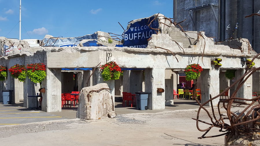Outdoor Cafe at Riverworks Color Pop Outdoor Cafe Buffalo New York Buffalo Buffalo,ny Buffalo Riverworks CanalSide Canalside Buffalo Waterfront Madusa Metal Garden Recycled Materials Concrete Structure Concrete Structures Buffalo Bar Googles Most Viewed Silo EyeEm Selects Architecture Sky Building Exterior Built Structure Whitewashed Entryway Open Door