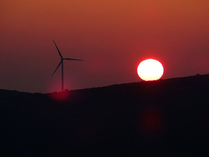 Alternative Energy Beauty In Nature Electricity  Environmental Conservation Fuel And Power Generation Industrial Windmill Nature No People Orange Color Outdoors Power In Nature Renewable Energy Scenics Silhouette Sky Sun Sunset Sustainable Resources Tranquility Wind Power Wind Turbine Windmill