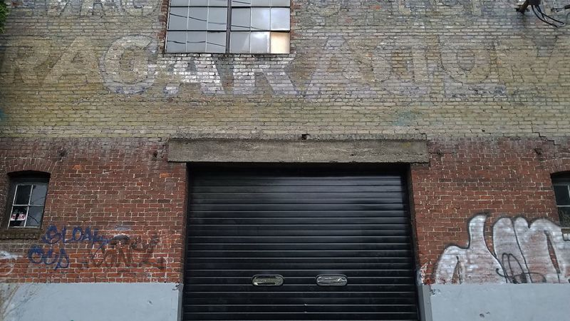 Architecture Built Structure Building Exterior Day No People Shutter Outdoors Corrugated Iron Close-up Street Art Brick Wall Door Graffiti Backgrounds Architecture Wall