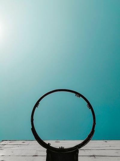 View of basketball hoop against blue sky