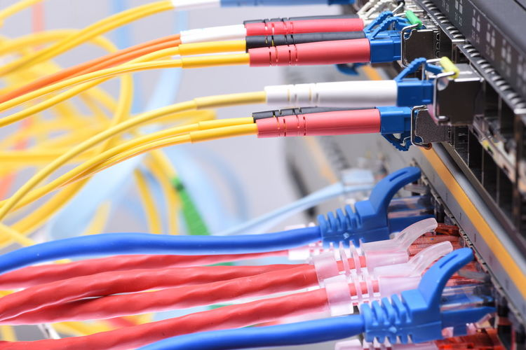 Network cables and switch in data center Switch Technology Communication Network Cable Internet Data Center Computer Router Plug Optical Illusion Information Broadband Digital Composite Speed Colorful Abstract Infrastructure Provider High Speed Bussiness Innovation Devices Close-up Engineering