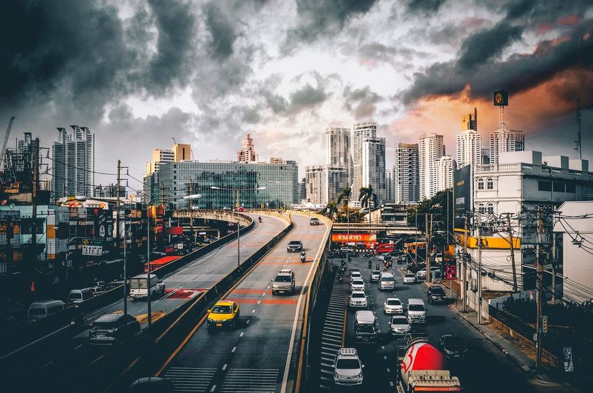 Day in Bangkok City Architecture Building Exterior Built Structure Sky Cloud - Sky Street Cityscape Transportation Road Building City Street Mode Of Transportation Urban Skyline No People