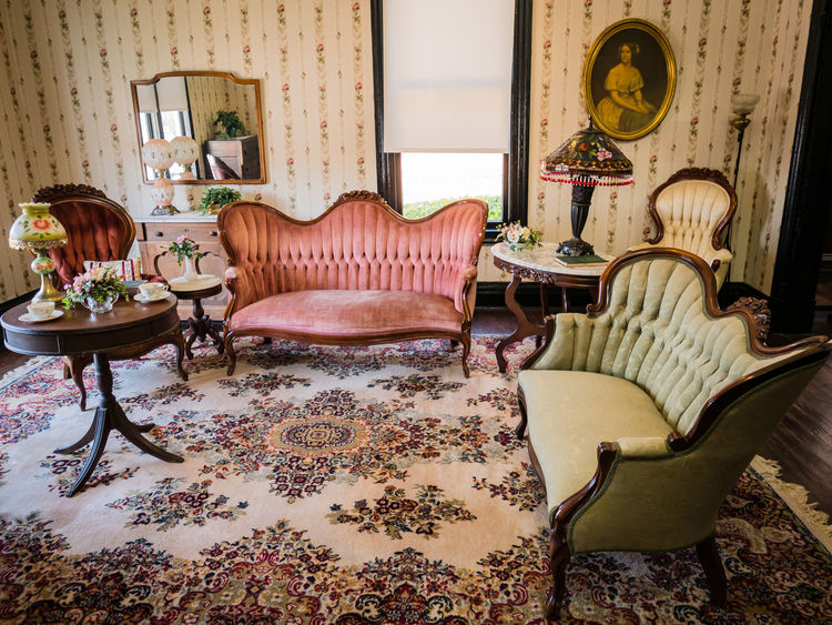 Antique Dresser Antique Floor Lamp Antique Furniture Antique Hurricane Lamp Antique Mirror Antique Rug Architecture Day Home Interior Home Showcase Interior Indoors  Living Room Marble Top Lamp Table No People Parlor Tiffany Lamp Victorian High Back Chairs Victorian Style Sofa Vintage Wallpaper