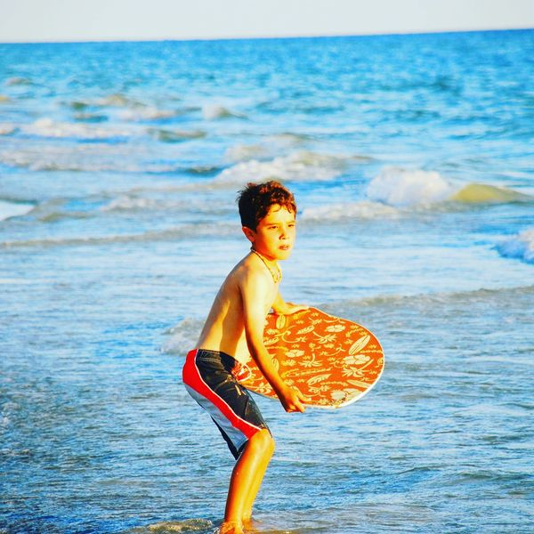 Boy Skimboard Skimboarding Shore Sea Water Horizon Over Water Leisure Activity Lifestyles Beach Vacations Standing Person Casual Clothing Carefree Elementary Age Childhood Scenics Focus On Foreground Blue Enjoyment Weekend Activities Fun Summer Florida The Portraitist - 2017 EyeEm Awards Mix Yourself A Good Time An Eye For Travel The Still Life Photographer - 2018 EyeEm Awards The Portraitist - 2018 EyeEm Awards The Traveler - 2018 EyeEm Awards This Is Natural Beauty