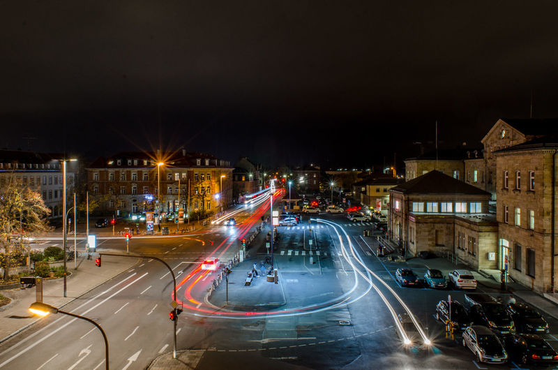 Illuminated City Architecture Night Building Exterior Street Built Structure Road Long Exposure Transportation Motion Light Trail City Life Building Street Light Blurred Motion City Street Speed High Angle View Car No People Outdoors Cityscape Light