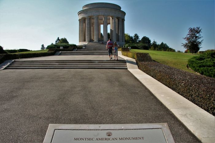 Montsec American Monument. The American First Army in its offensive operation of September 12-16, 1918 reduced the strongly fortified St. Mihiel salient, capturing 15,000 prisoners, 450 cannon and 700 square kilometres of territory. This monument has been erected by the United States of America to commemorate the capture of the St. Mihiel Salient by the troops of the First Army and to record the services of the American Expeditionary Forces on the battle front in this region and elsewhere in Lorraine and Alsace. It stands as a lasting symbol of the friendship and co-operation between the French and American armies. http://pics.travelnotes.org/ American Couple France Holding Hands Memorial Michel Guntern Montsec American Monument St Mihiel Sunny Travel Photography United States Blue Sky Clear Day French Landscape Monument Outdoors People Real People Summer Tourism Travel Travelpics View From Behind Wide-angle