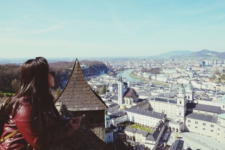 Salzburg, Austria Cityscape City Women Rear View Sitting Sky Architecture Pyramid Office Building Egyptian Culture Triangle Pyramid Shape Urban Skyline Archaeology