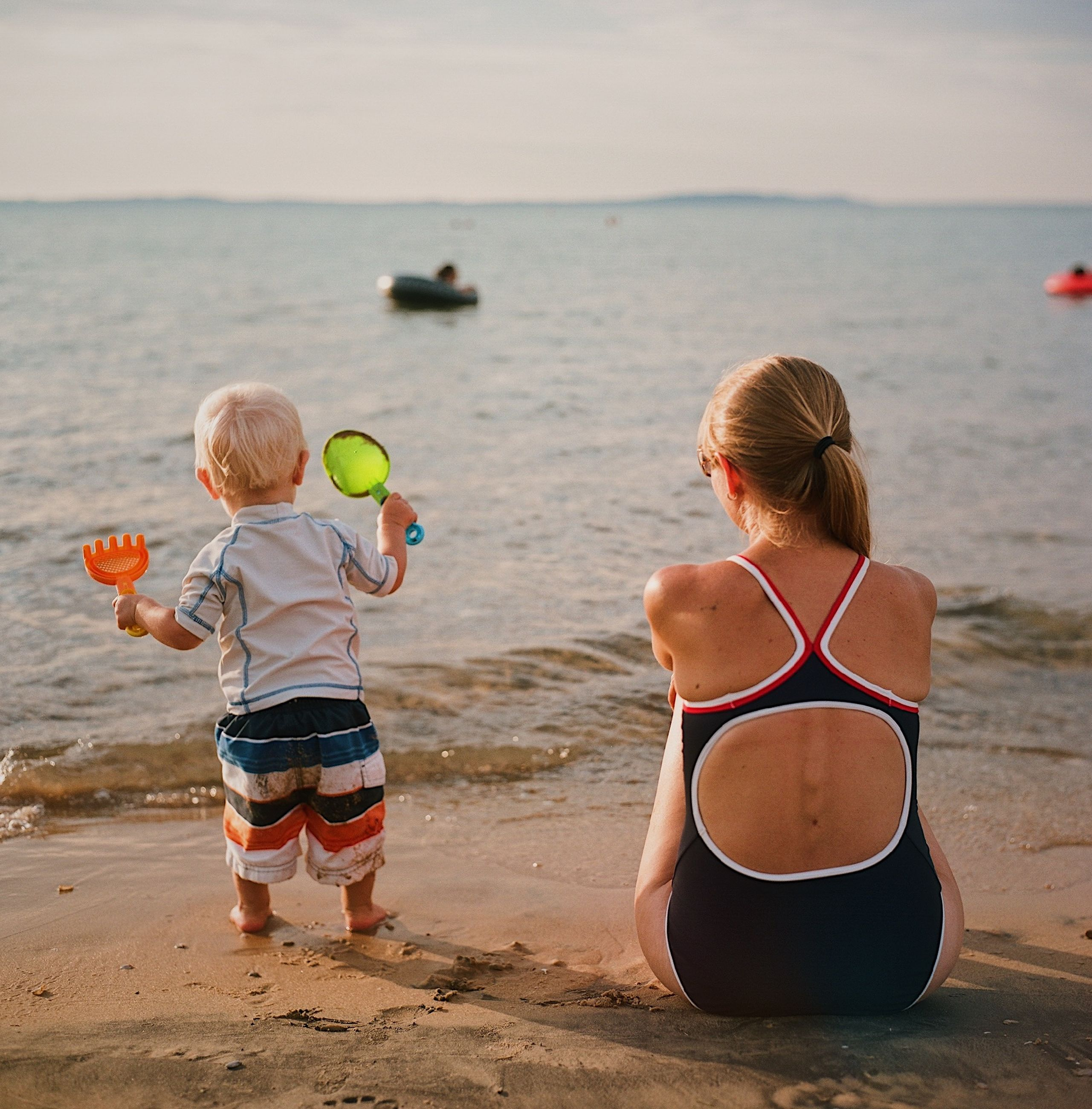 water, sea, beach, land, childhood, child, real people, family, two people, lifestyles, sand, boys, women, rear view, leisure activity, males, togetherness, nature, females, horizon over water, outdoors