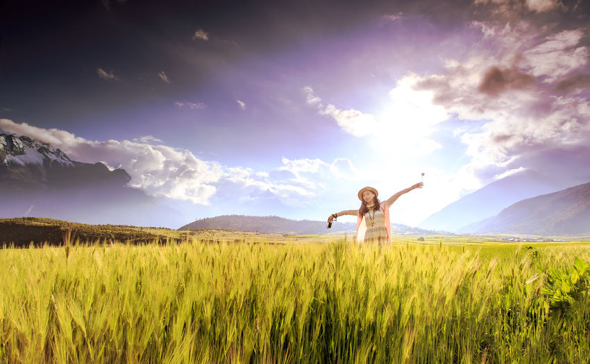 Girl cheering in the wheat field Backlight Beautiful People Beauty Blowing Cheering Chinese Girl Dreams Field Free Hands EyeEmNewHere Lifting Model Mood Captures Mountain Nature Outdoors Pretty Girl Romantic Sky Vacations Wheat Women Young Adult
