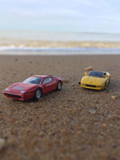 Toy Toy Car Beach Selective Focus Childhood Day Transportation Car No People Sand Outdoors Close-up Nature Sky
