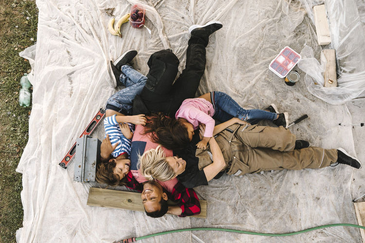 High angle view of people relaxing on floor