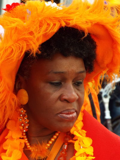 A lady all dressed up in orange for the Kingsday/Koningsdag celebrations April 27th 2016 Celebrations Close-up Flower Fragility Headshot Human Face Kings Day In Holland Kingsday 2016 Kingsday2015 Koningsdag 2016 Koningsdag2015 Leisure Activity Lifestyles Orange Color Orange Colour Orange Feathers Person Portrait