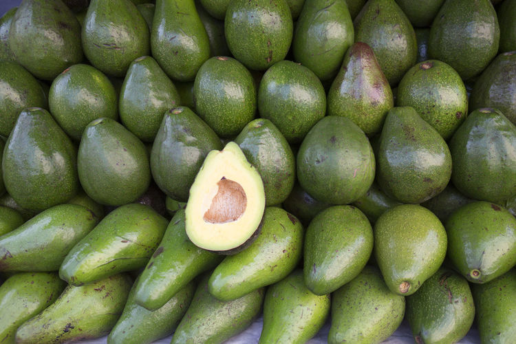 Fresh Avocado Healthy Eating Fruit Food And Drink Food Green Color Wellbeing Freshness Full Frame Large Group Of Objects Abundance Backgrounds Market Retail  No People Market Stall Close-up For Sale Ripe Directly Above Heap Sale