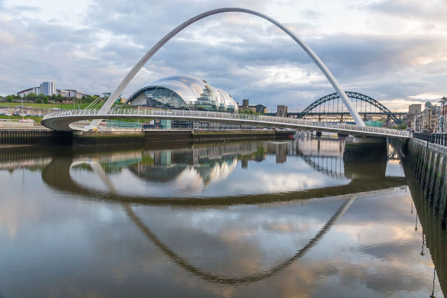 Reflections on the River Tyne Bridges Newcastle Upon Tyne River Tyne, Sage Building Arch Architecture Bridge - Man Made Structure Building Exterior Built Structure Cloud - Sky Connection Day Milenium Bridge Modern Nature No People Outdoors Reflection Sky Water Waterfront