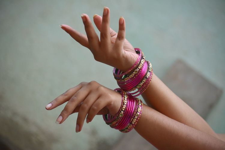 Cropped hand with bangles