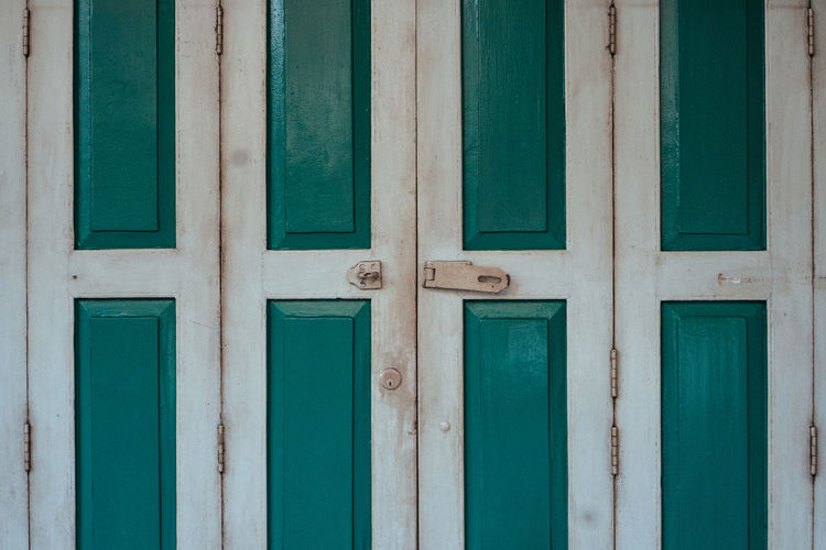 Entrance Door Wood - Material Backgrounds Closed Security Full Frame Architecture No People Protection Safety Built Structure Green Color Day Building Exterior Pattern Outdoors House Building Turquoise Colored