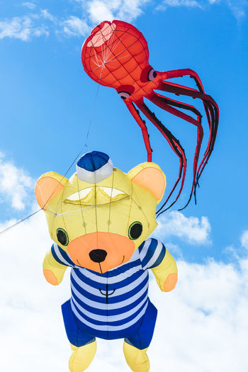 Flying kite with red octopus-shaped and bear animal