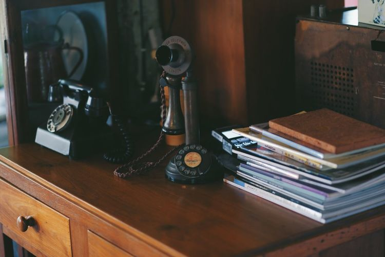 Analog Antique Book Communication Connection Desk Furniture Indoors  No People Nostalgia Old Publication Retro Styled Stack Still Life Table Technology Telephone Wood - Material